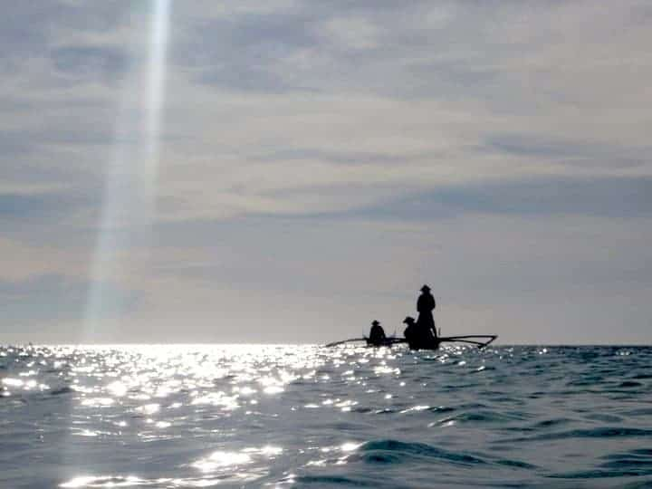 People are fishing in Camiguin Island, Philippines. maninio.com #tourismphilippines #visitcamiguin