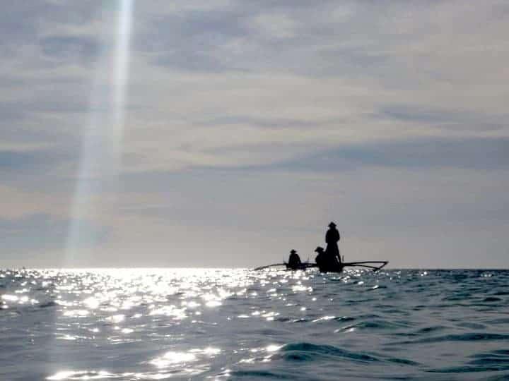 People are fishing in Camiguin Island, Philippines. maninio.com #tourismphilippines #visitcamiguin