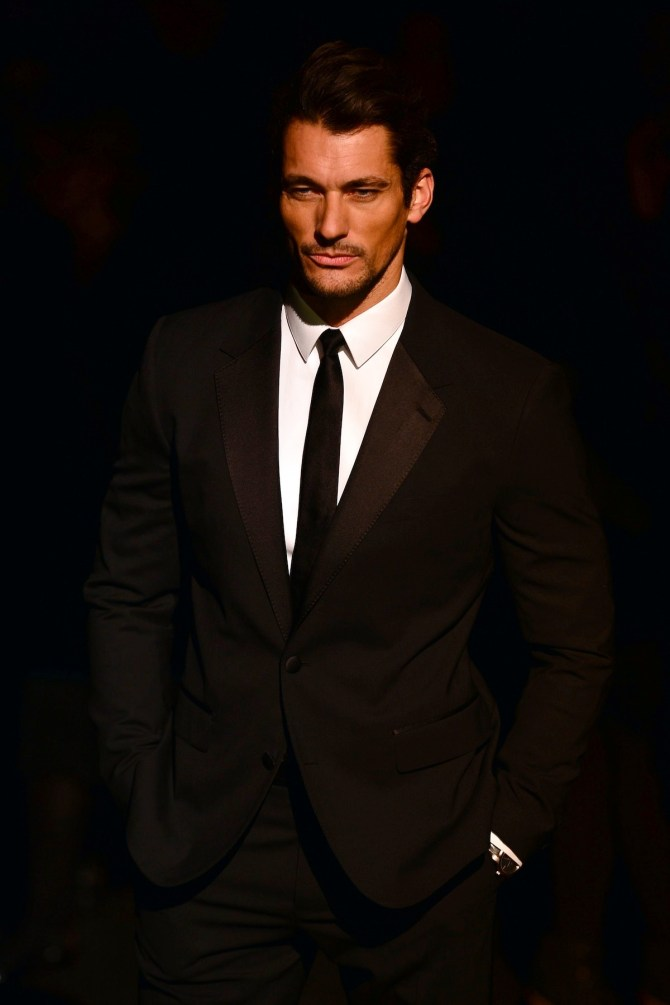 Model David Gandy poses prior the Dolce & Gabbana Fall-Winter 2013-2014 Womenswear collection on February 24, 2013 during the Women's fashion week in Milan. AFP PHOTO / GIUSEPPE CACACE