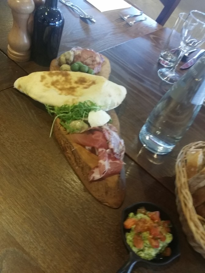 The board is used to bash the ham and then serve with bread and huge olives