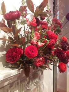 Red flower bouquet peonies red sweet pea, delphiniums