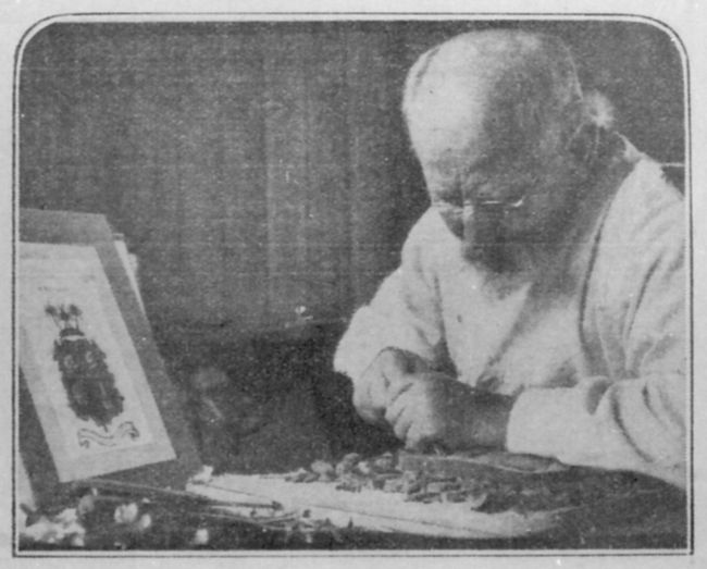 Mr R. Prenzel at work on a Queenslandcoat of arms for the Young Australia League