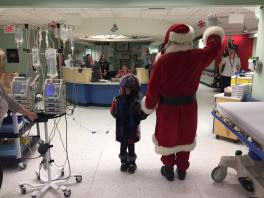 Santa and Neveah show off her new threads around the Janeway Hospital