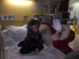 Neveah and Santa share a special moment after the surprise gift was presented to her.