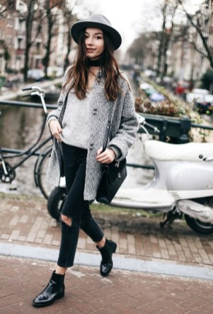 gray-shirt-tweed-coat-wide-brim-hat-distressed-pants-and-black-bag