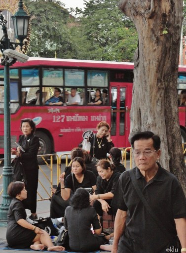 Usually one of the most vividly dressed people were in mourning for their king. BKK.