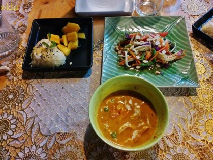"""Results of cooking class in Chiang Mai: sticky rice with coconut, papaya salad, tom yum soup. (""""It was yum indeed"""", she said.)"""