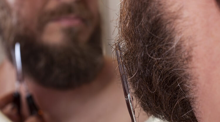 Grooming your full beard with a scissors