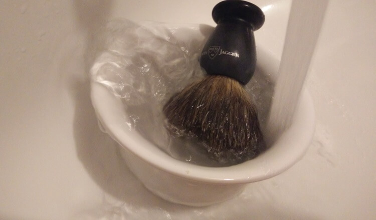 How to use a shaving brush properly. Rinse it thoroughly with water once you finish shaving