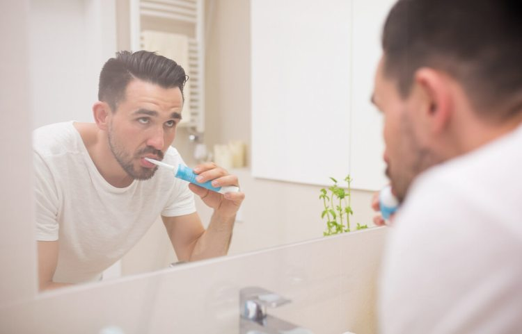 Brushing your teeth regularly is one way to cure bad breath