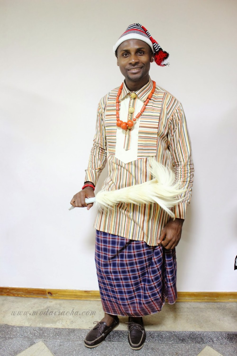 man Idressed in gbo traditional with cover shoe