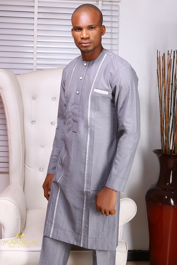 A Model Wearing Nigerian Men Traditional Wears Clothes designed by Chidiebere Ekwunife AKA Marobuk