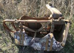 This image shows the side view of the Slumberjack Rail Hauler 2.0 hunting backpack.