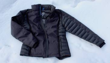 This KÜHL Firestorm Down Jacket review photo shows the front of the Firestorm Down Jacket on snow.