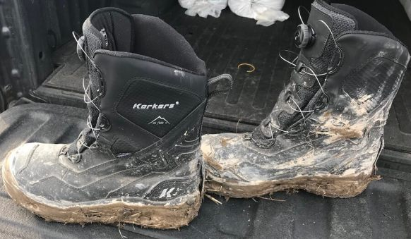 This image shows the Korkers Polar Vortex 600 boots covered in mud.