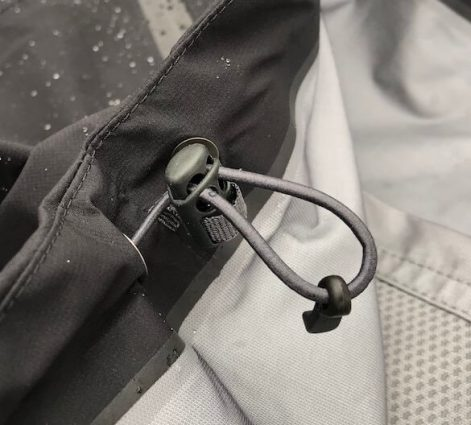This image shows the hem cord on the Drypoint GTX rain jacket.