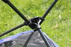 This photo shows the bottom connection bracket of the REI Co-op Flexlite Macro Camp Chair.