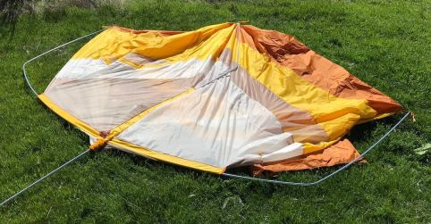 This photo shows the Big Agnes Big House 4 Deluxe tent on the ground not yet set up.