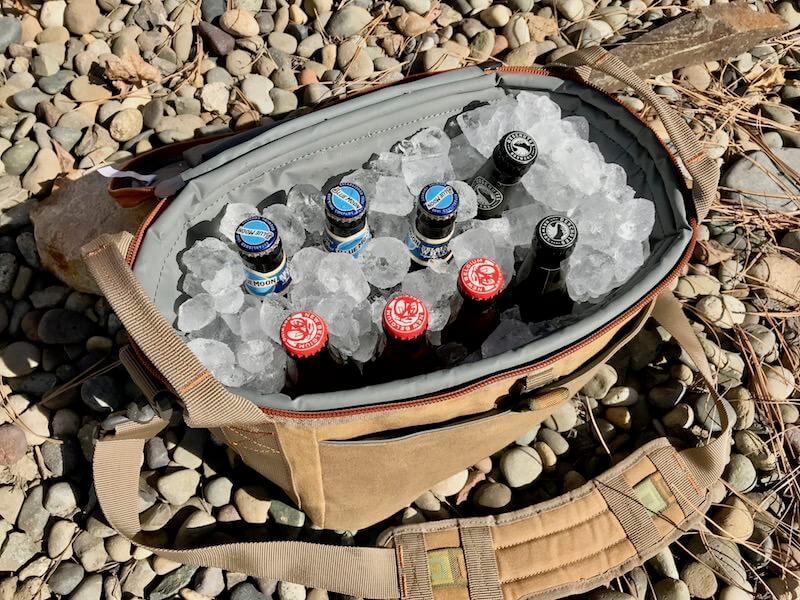 This photo shows the Fishpond Blizzard Soft Cooler filled with ice and drinks.