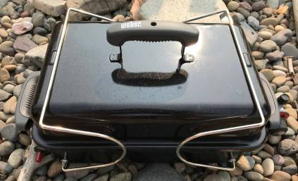 This photo shows the Weber Go-Anywhere Gas Grill with the legs folded for travel.