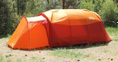 This photo shows the REI Co-op Kingdom 8 Tent with the Mud Room Accessory attached and closed.