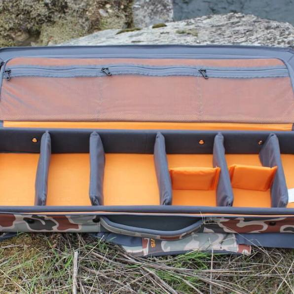 This review photo shows the Orvis Safe Passage Carry It All fly fishing travel bag case open and empty.