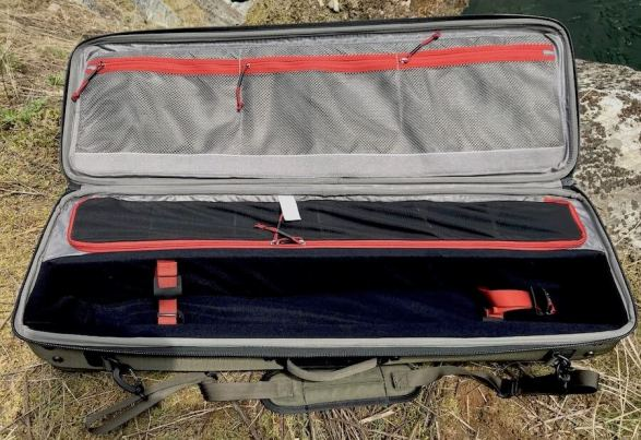 This photo shows the empty interior of the Simms Fishing Bounty Hunter Vault Duffel.