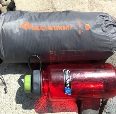 This photo shows the Sea to Summit Ether Light XT Insulated Air Sleeping Mat with the included Airstream pumpsack.