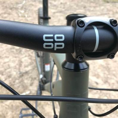 This photo shows The REI Co-op Cycles handlebars on the REI Co-op Cycles DRT 1.2.