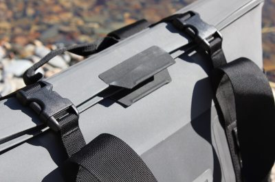 This photos shows the top of the YETI Hopper M30 'HydroShield' magnetic closure buckled down in a closeup.
