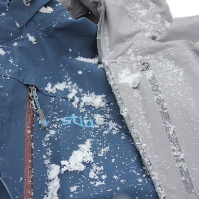 This photo shows the Stio Environ jacket next to the Stio Raymer jacket.