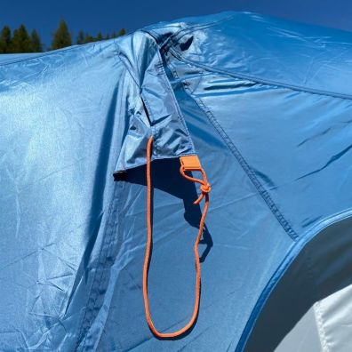 This review photo shows the Eureka! Copper Canyon LX 6 Tent guy line pocket on the rain fly.