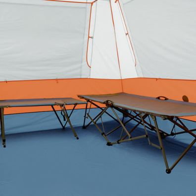 This photo shows the Eureka! Copper Canyon LX 6 Tent with cots set up inside.