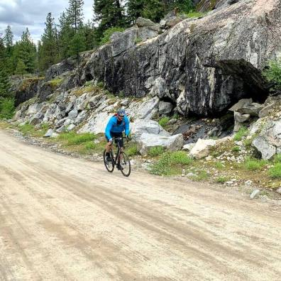 This photo shows the author riding on a gravel road.