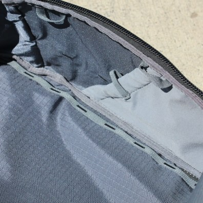 This photo shows the interior of the Able Carry Max Backpack.