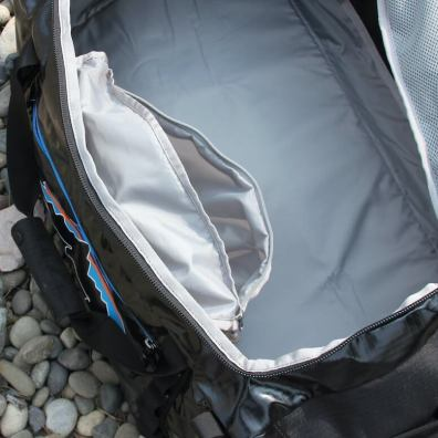 This photo shows the pass-through pocket on the Black Hole Duffel.