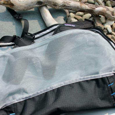 This photo shows the interior mesh pocket on the Black Hole Duffel.