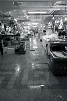 Walking along the stalls at Chinatown Market