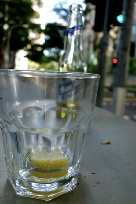 A lonesome glass with lemon and ants in the abandoned CBD