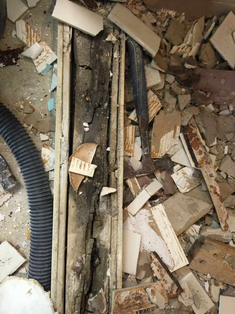 Curb rotted from shower failure