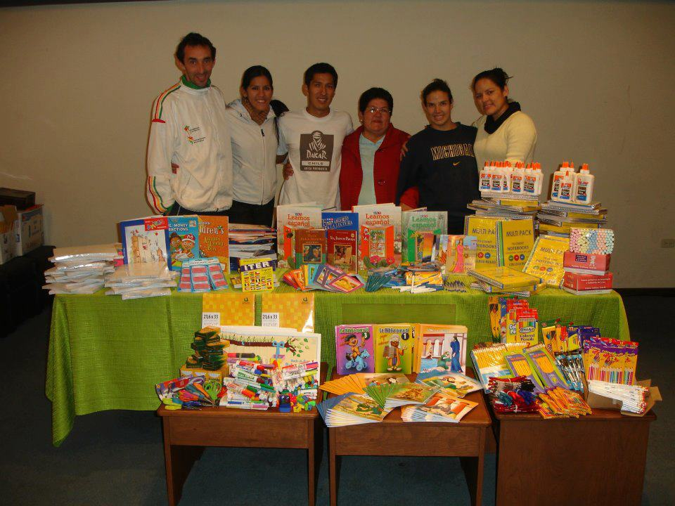 Mano a Mano staff and volunteers donate school supplies to teachers in San Lorenzo.
