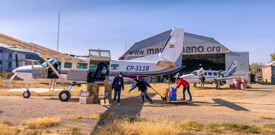 Loading supplies and equipment at the Mano a Mano hangar in Cochabamba for distribution in the department of Beni, 2020.