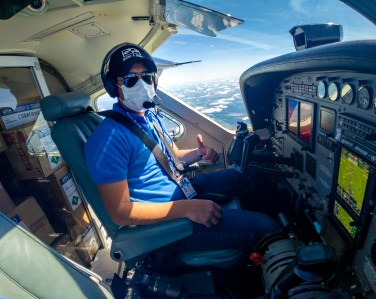 Mano a Mano pilot Ivo Daniel Martinez on a flight transporting medical supplies and equipment.