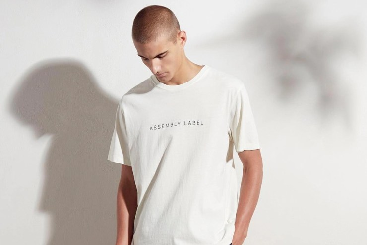 male model in assembly label white tshirt