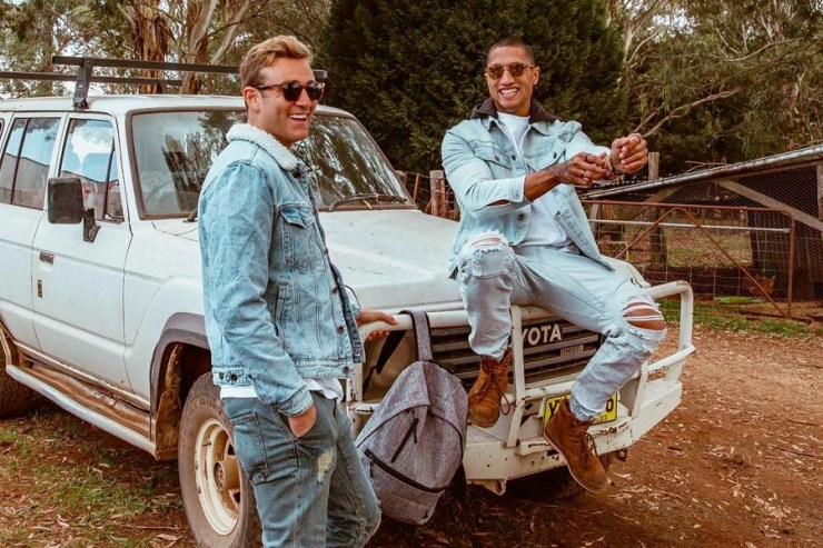 two men in cotton on denim outfit on car