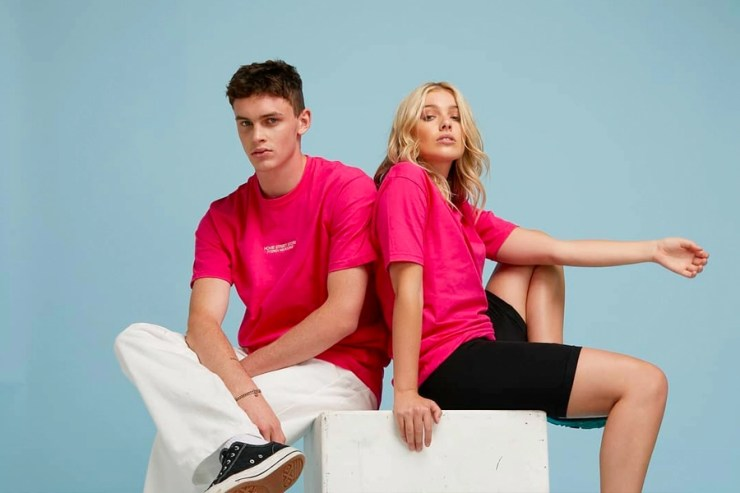 couple in pink HoMie shirts