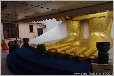 Feet of giant Standing Buddha -- Bangok Thailand
