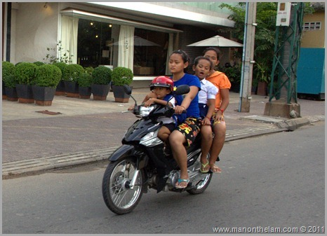 Four kids on scooter