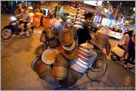 Hat vendor on bicycle, Hanoi, Vietnam