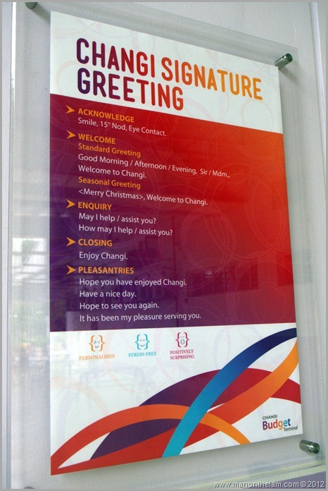 Singapore Changi Airport -- Greet, Smile, Thank program sign -- signature greeting